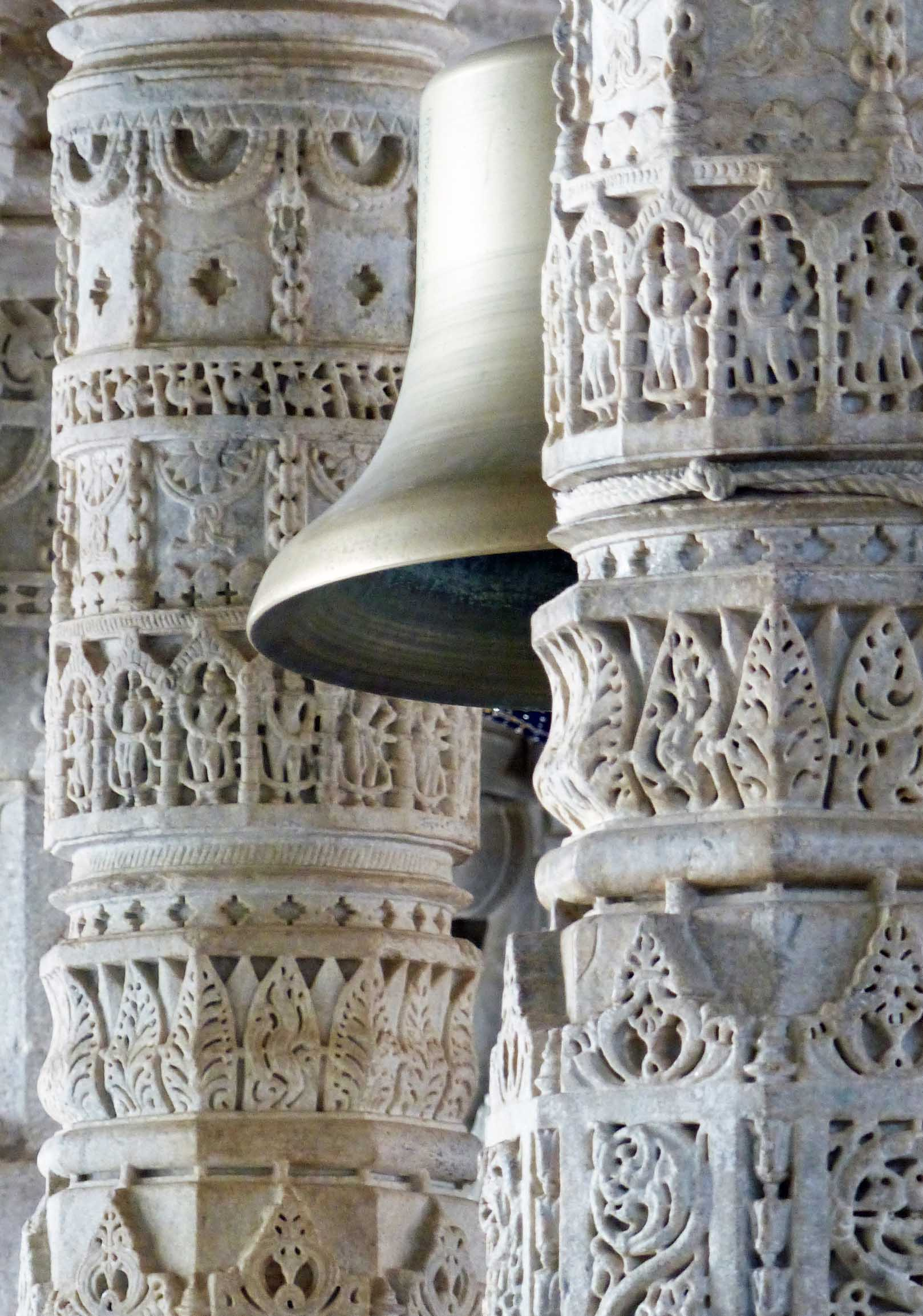 Ornate marble pillars and bell