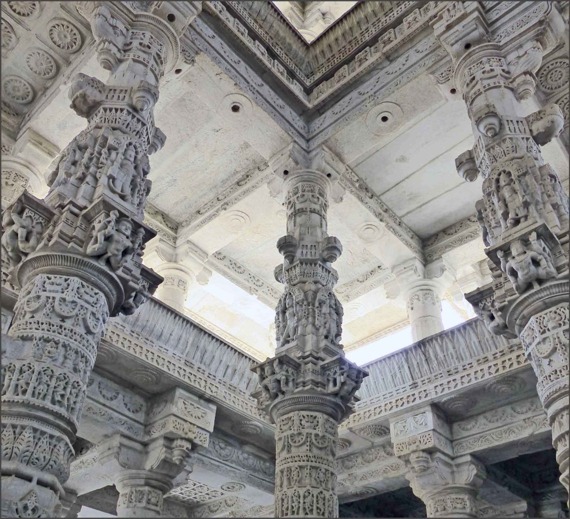 Ornate marble pillars holding up carved ceilings