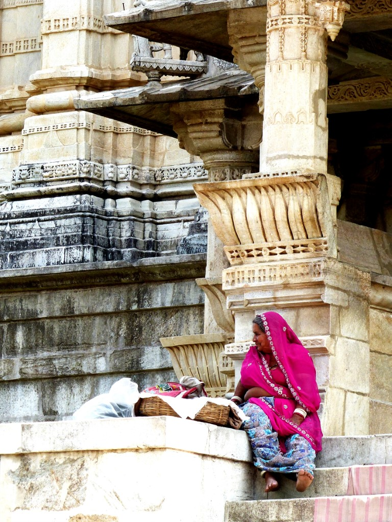 Lady in pink sari on temple steps