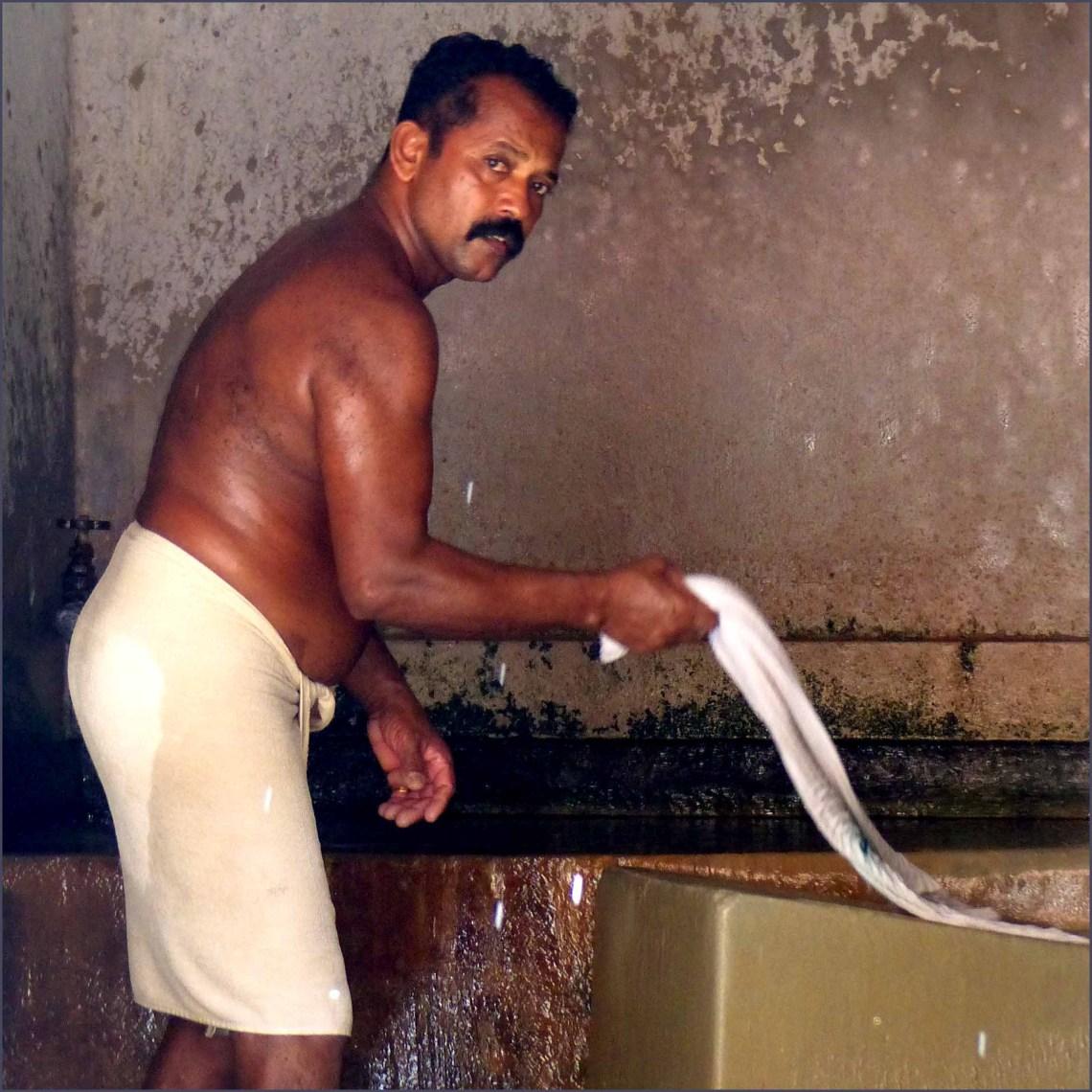 Man beating white cloth