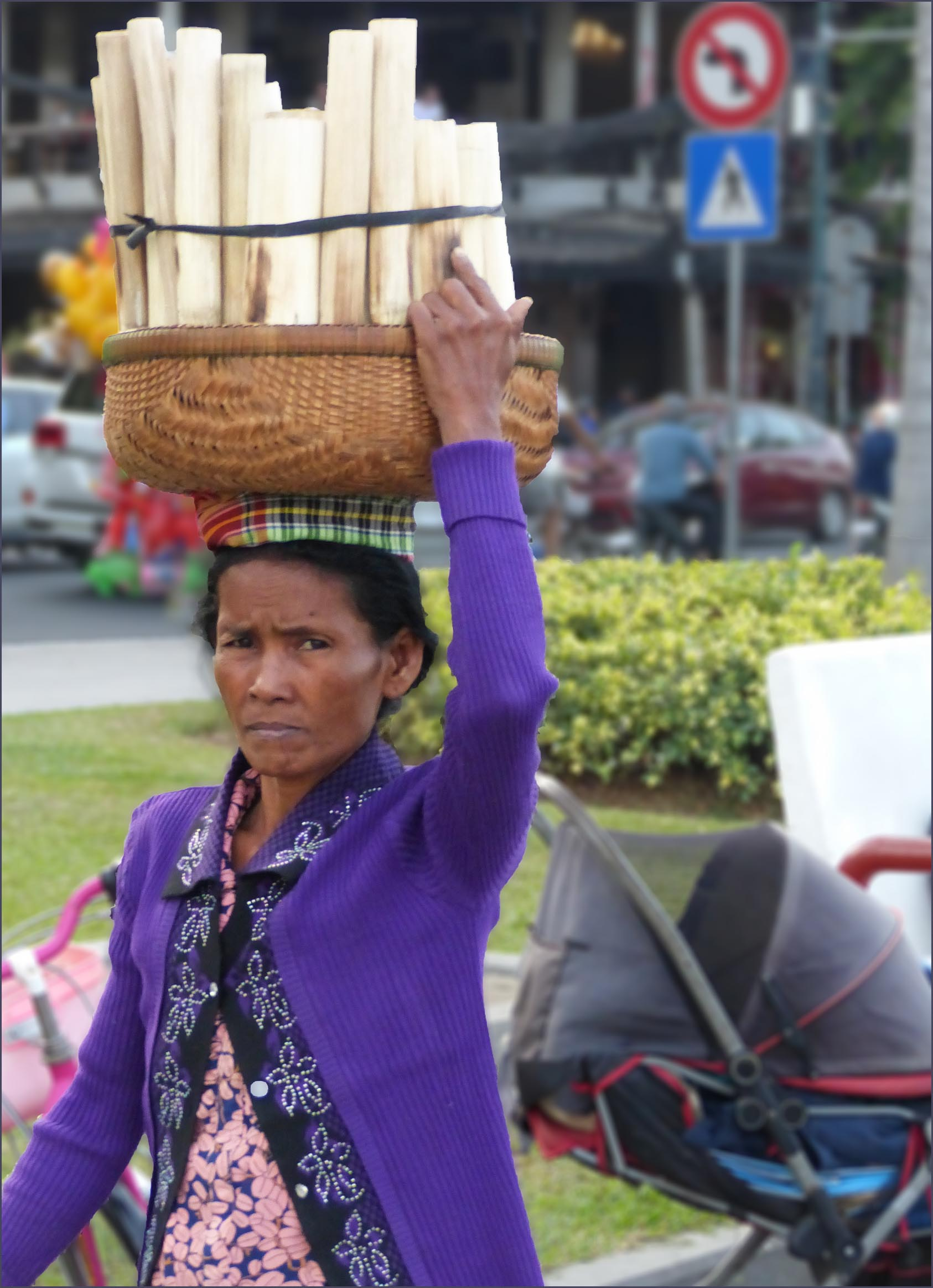 Woman with basket on her head