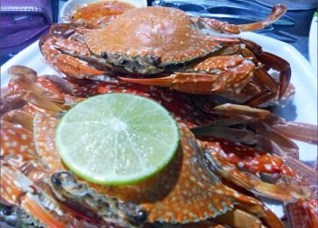 Crabs in their shells with a slice of lime