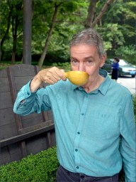 Man drinking from gourd