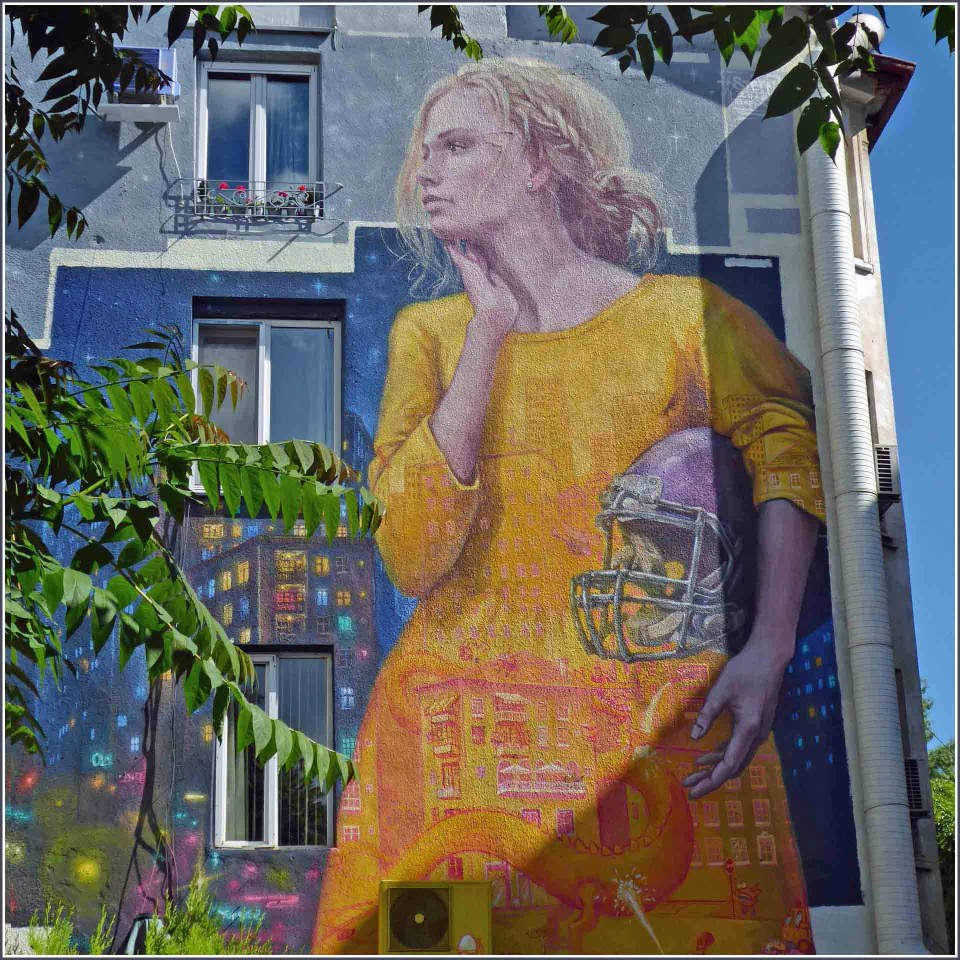 Huge mural of a girl in a yellow dress