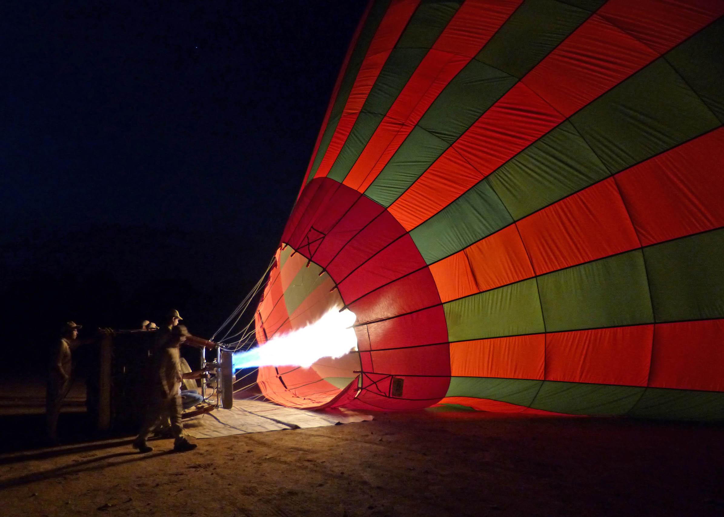 Men inflating a hot air balloon