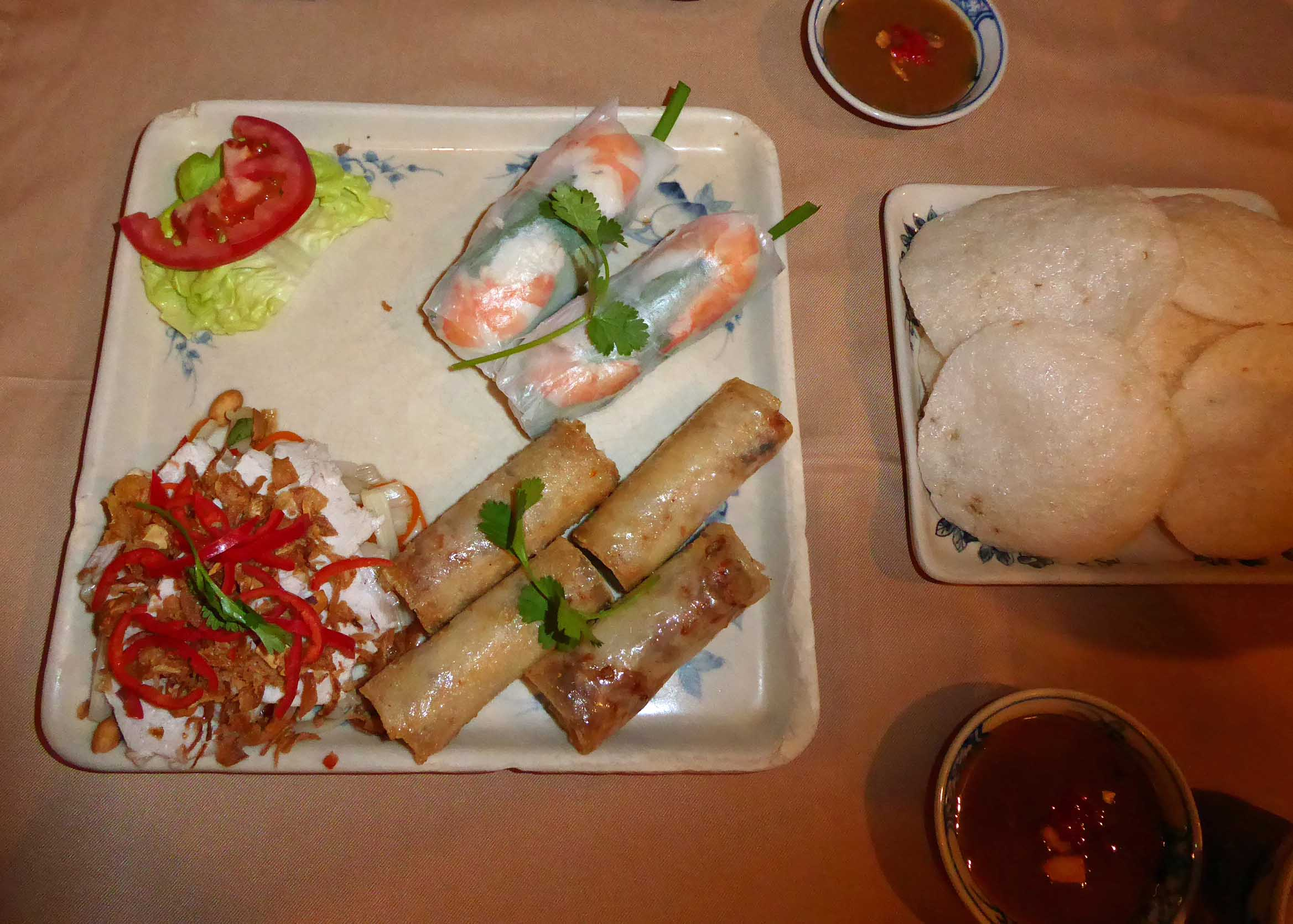 Square plate with spring rolls and salad