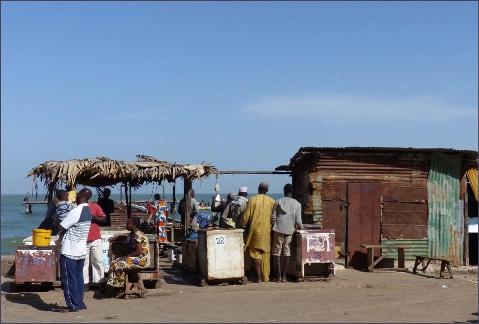 Stalls of corrugated iron near the sea