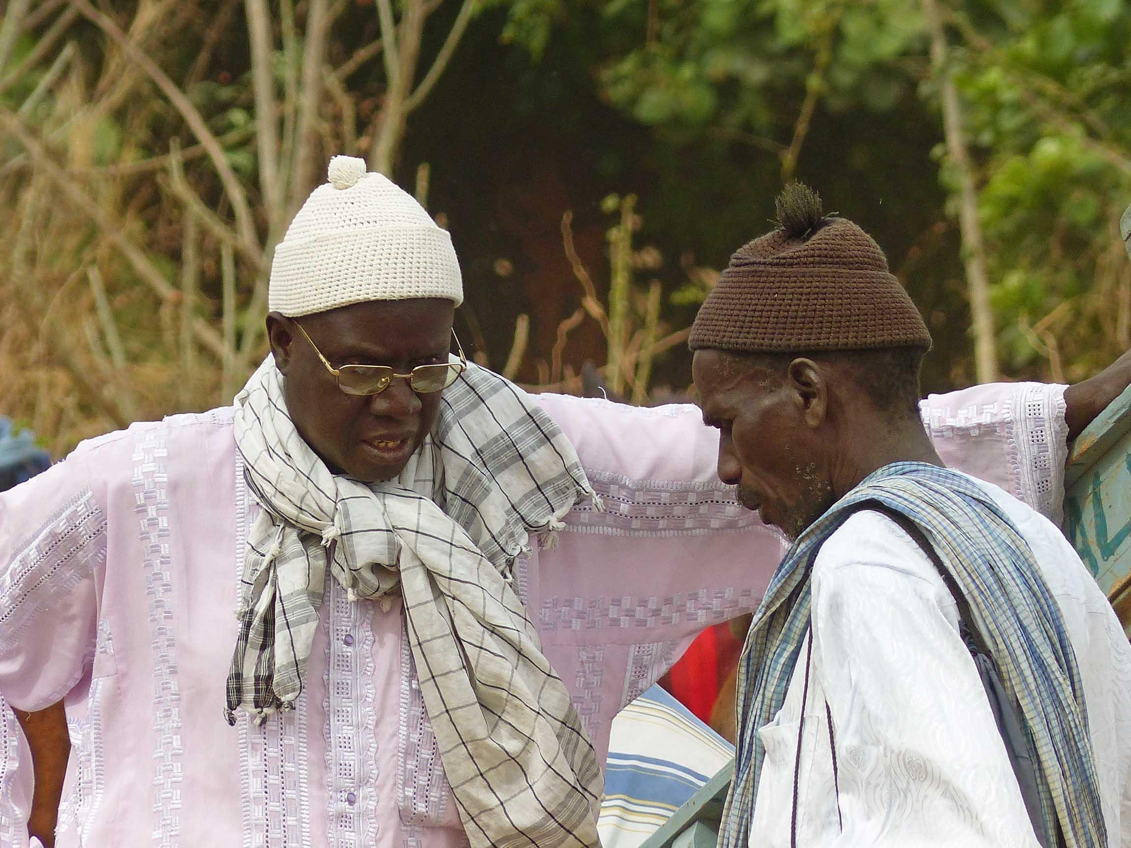 Two men in African dress talking