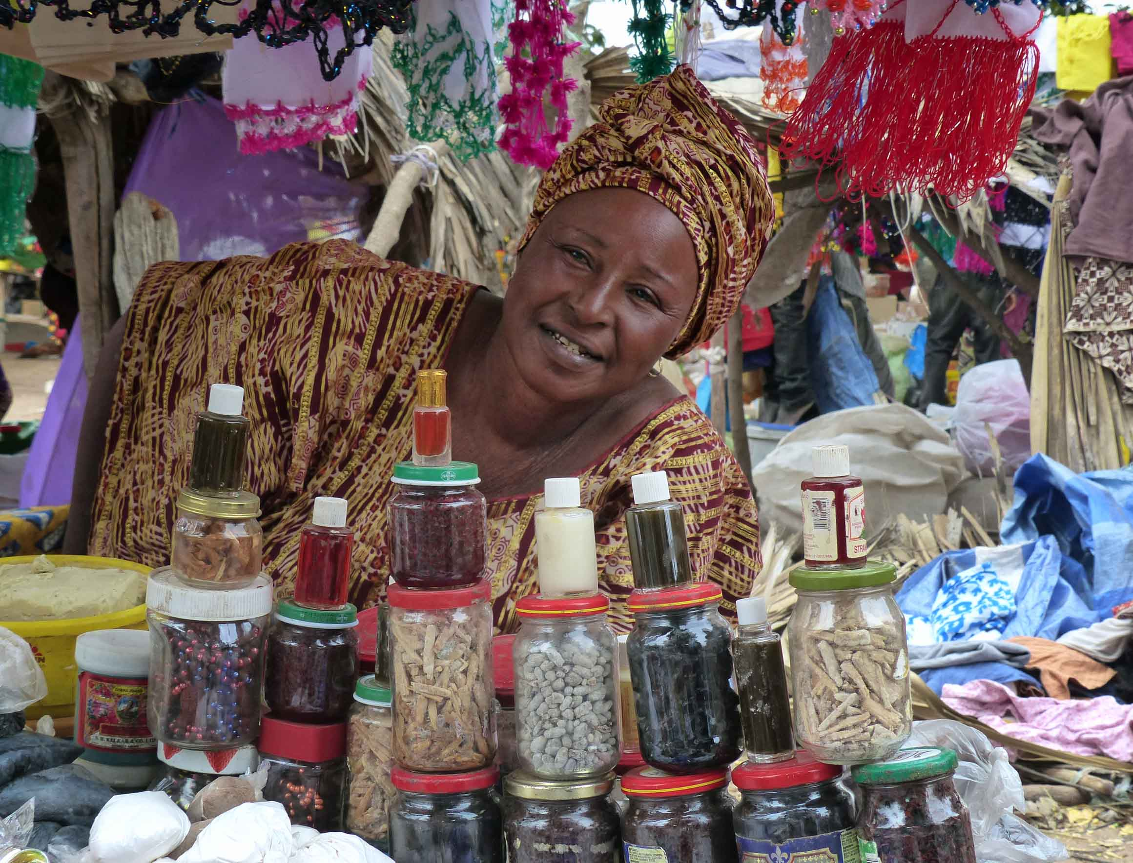 Woman in African dress with assorted jars