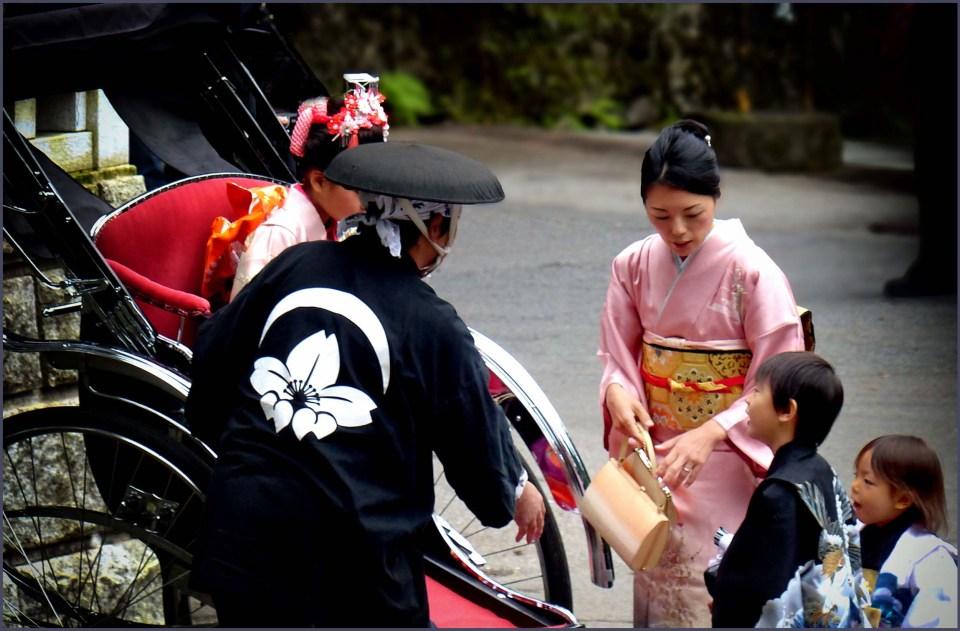 Japanese family around a rickshaw