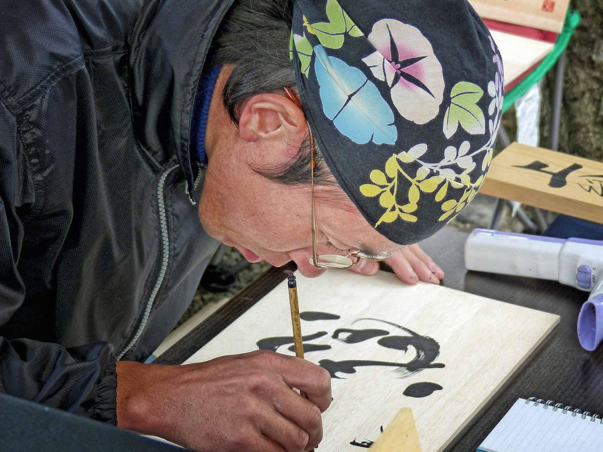 Man doing calligraphy
