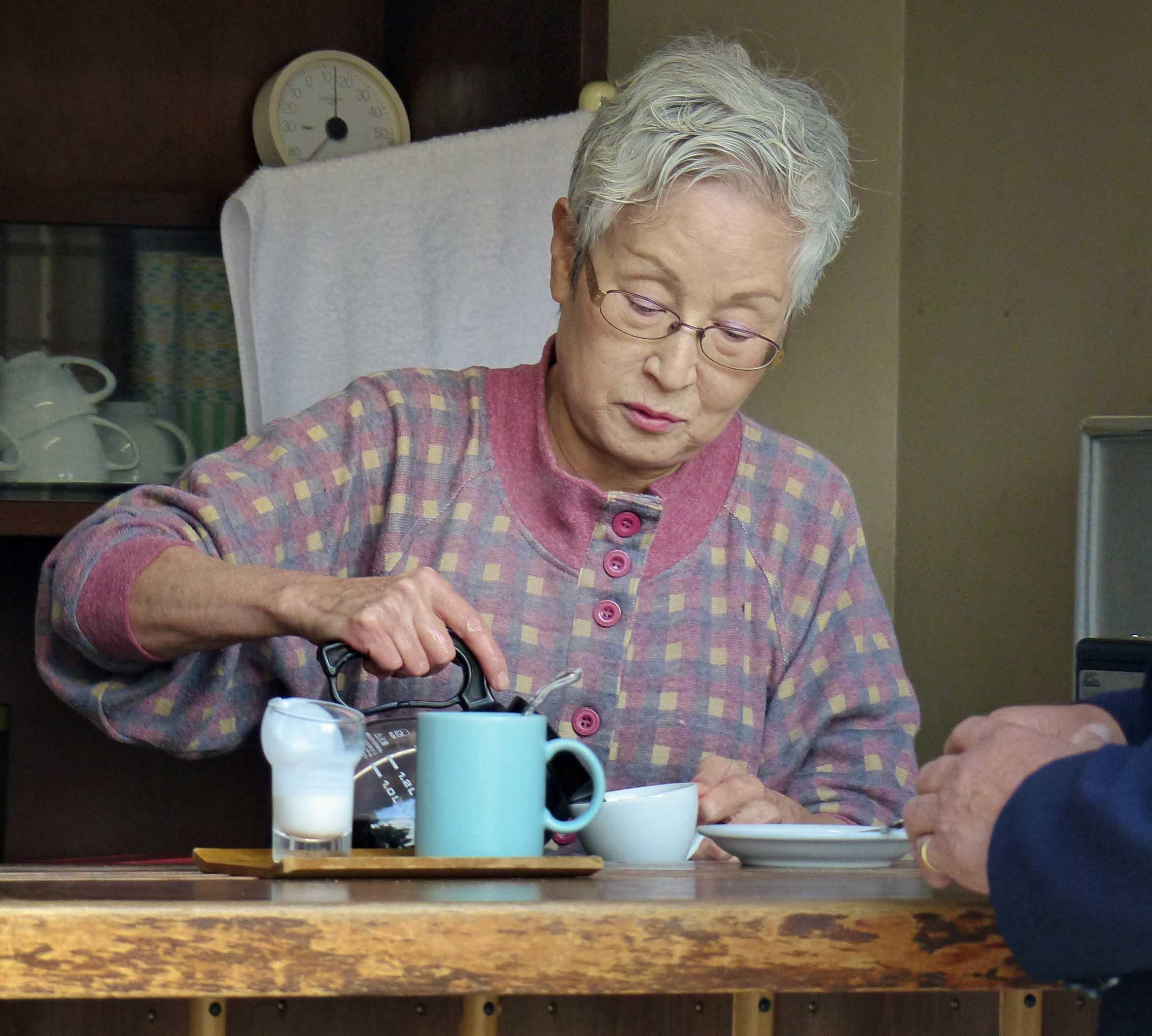 Lady pouring tea