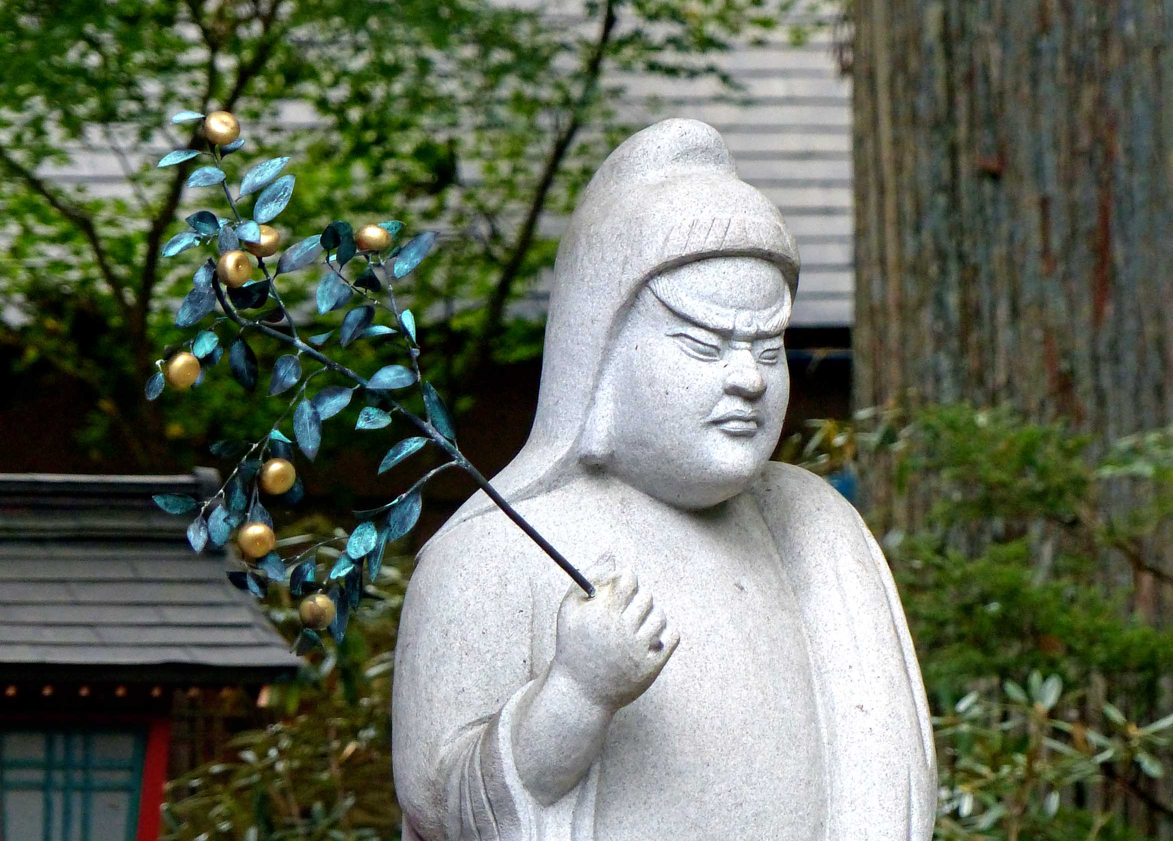 Simple grey statue of a buddha