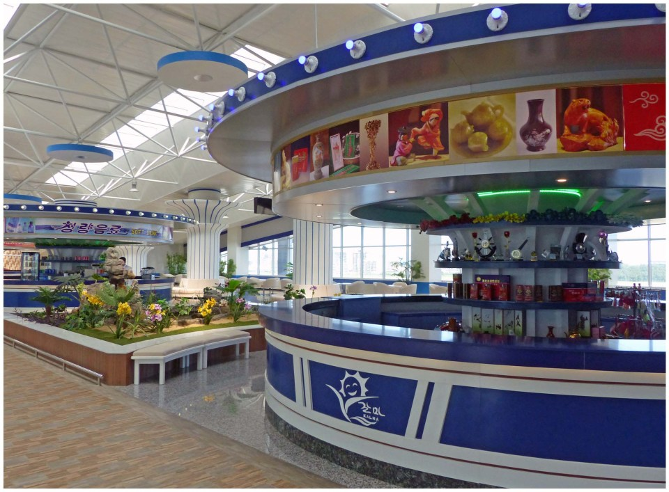 Shiny airport with deserted refreshment stalls
