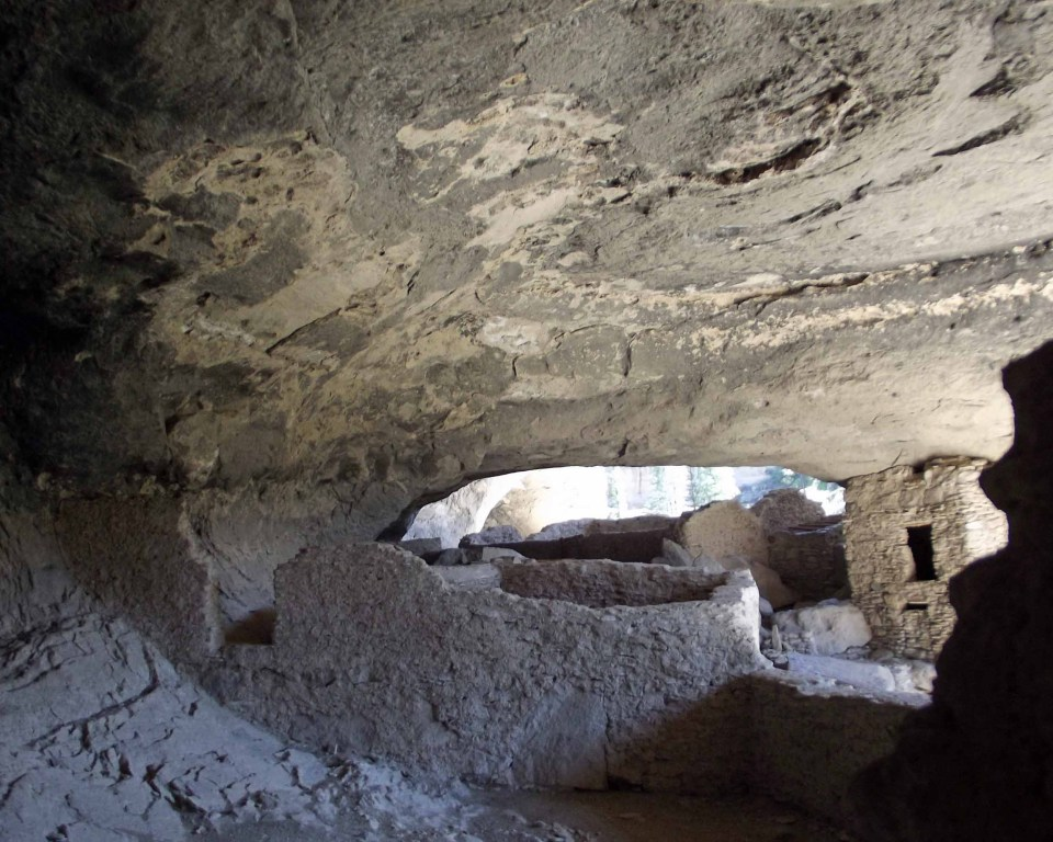 Inside a cave with walls and structures