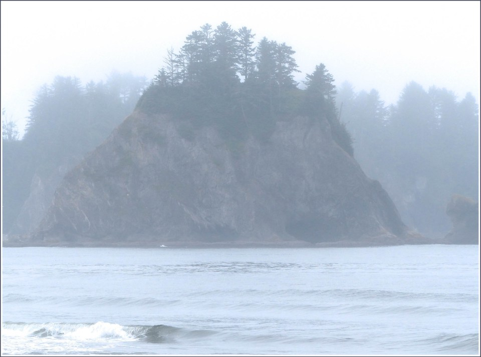 Misty sea stacks