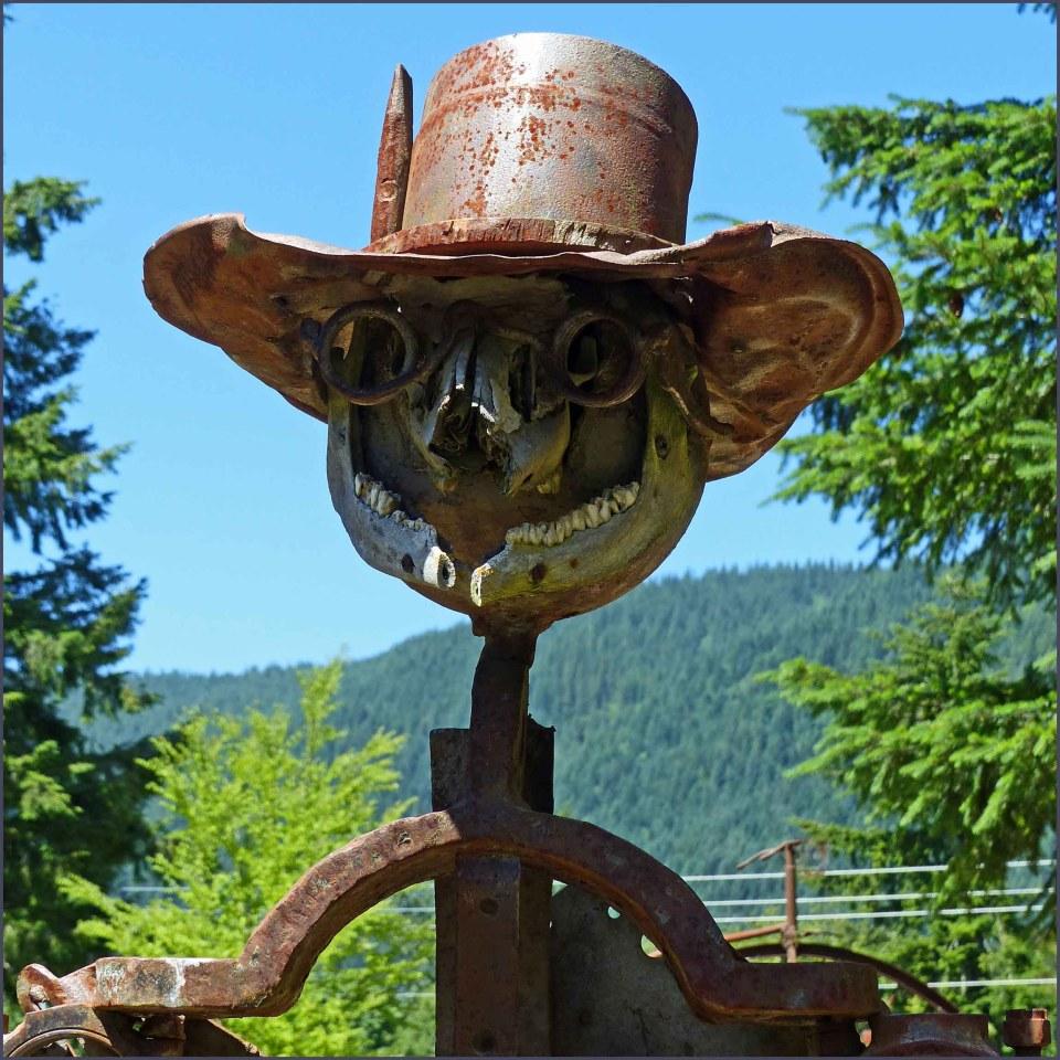 Scarecrow figure created from scrap iron etc