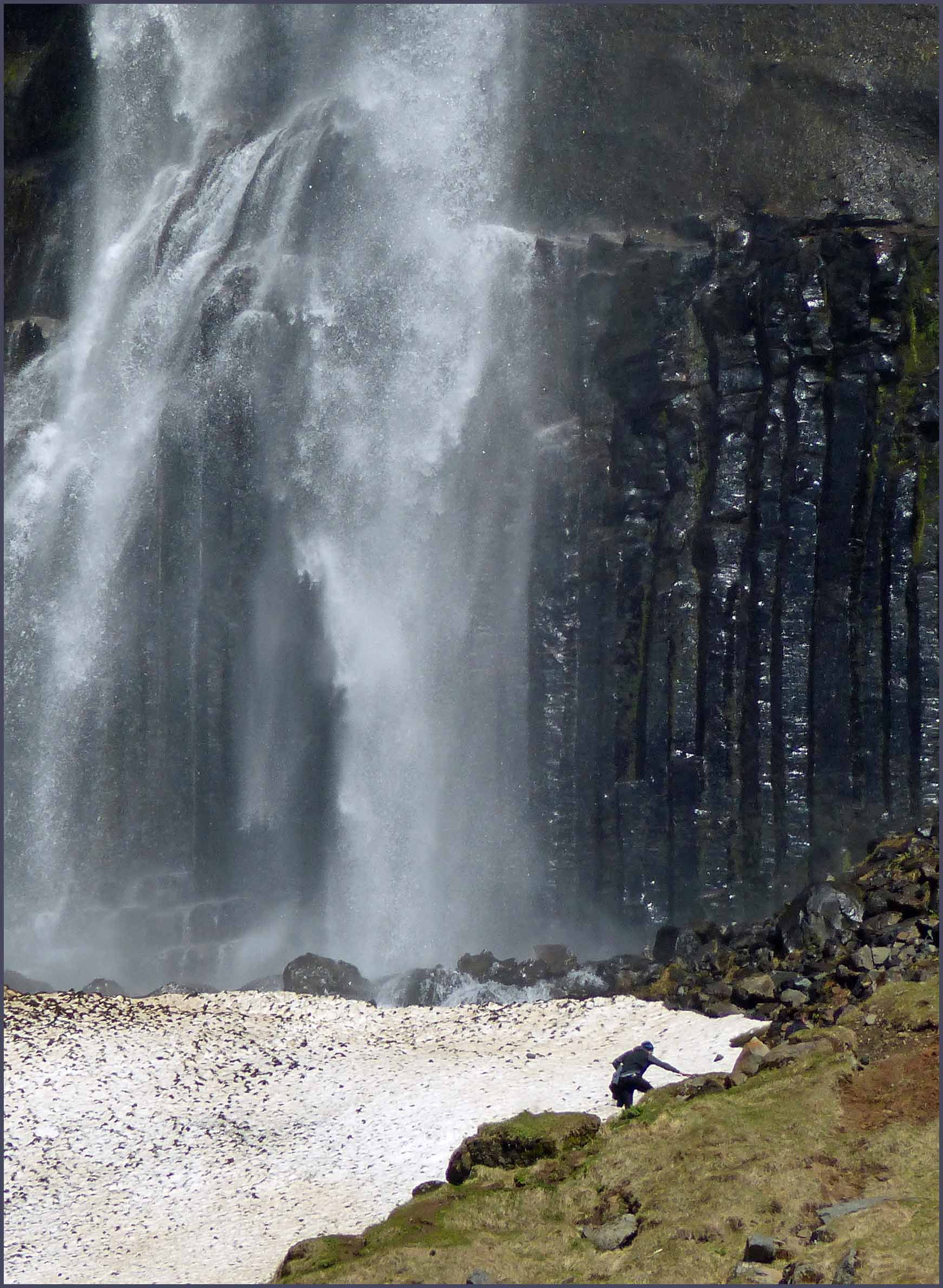 Veil-like waterfall with person in front