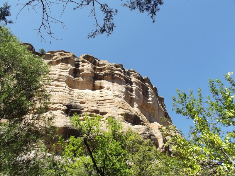 Looking up at a sandstone cliff