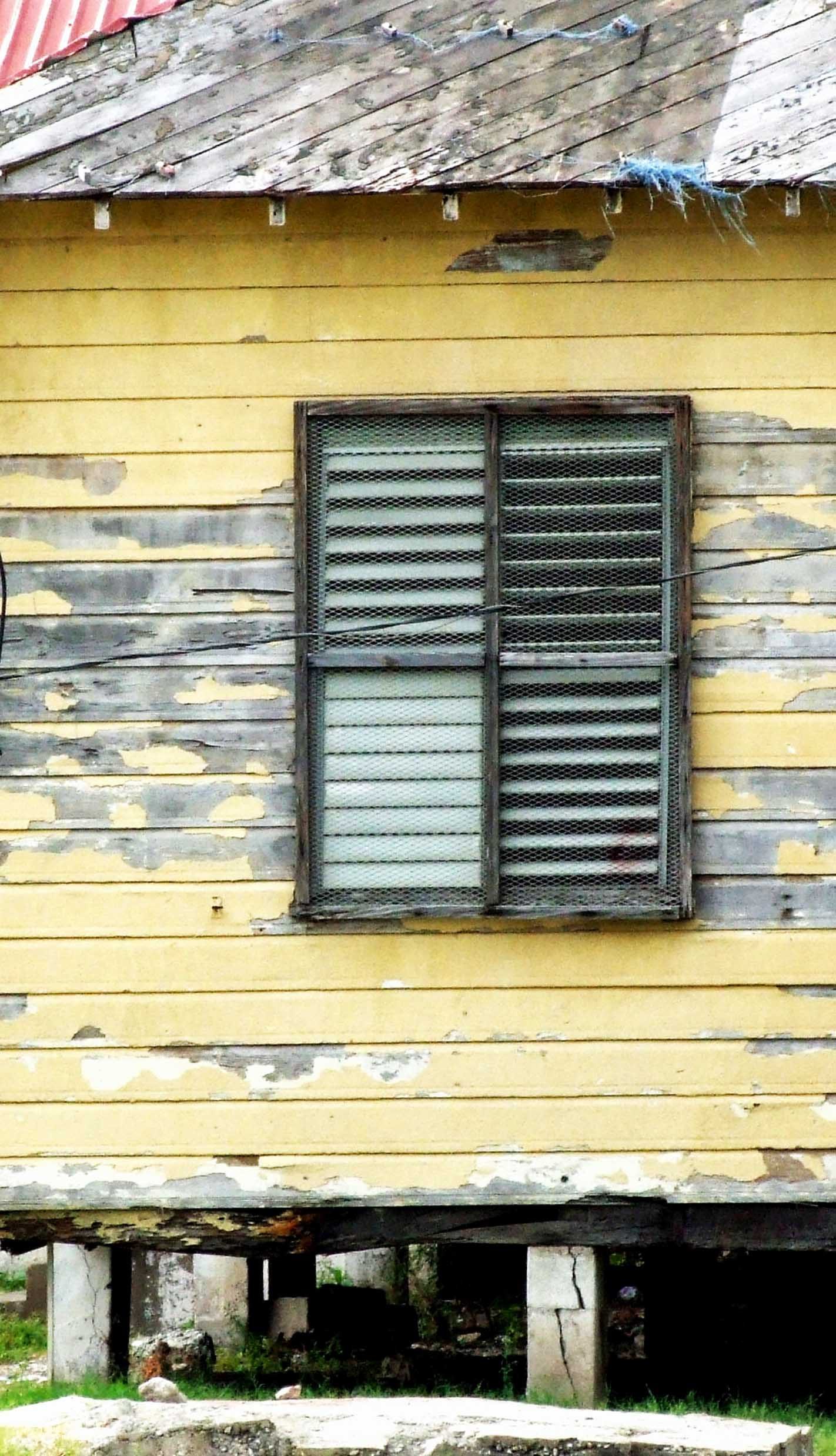 Tumbledown wooden building with shutter