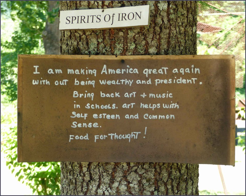 Sign on a tree calling for art and music in schools