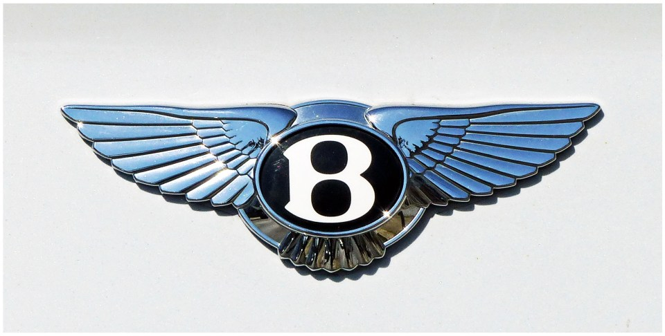 Metallic letter B with wings