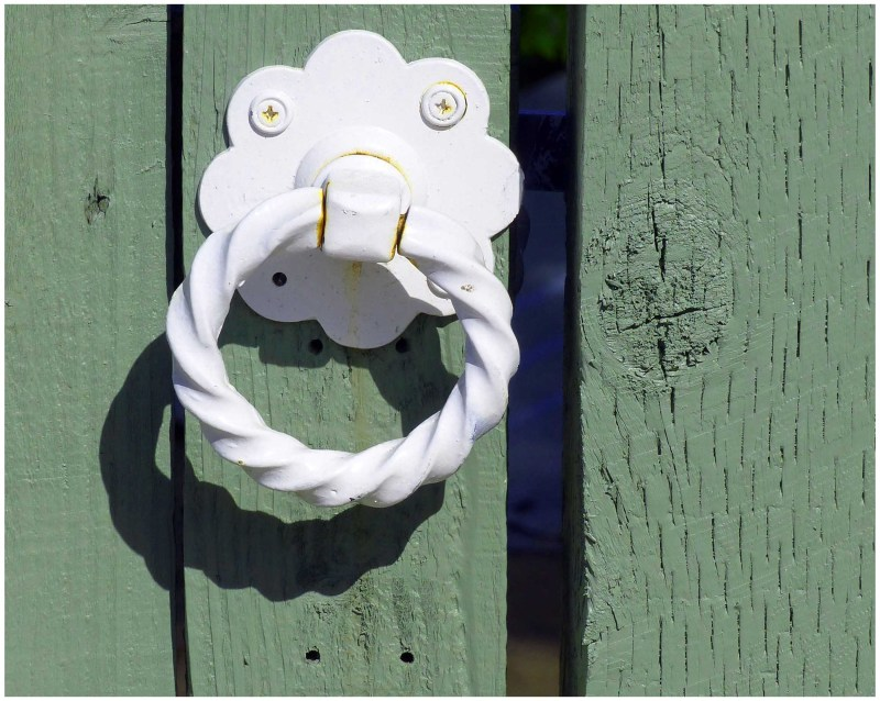 White handle on green gate