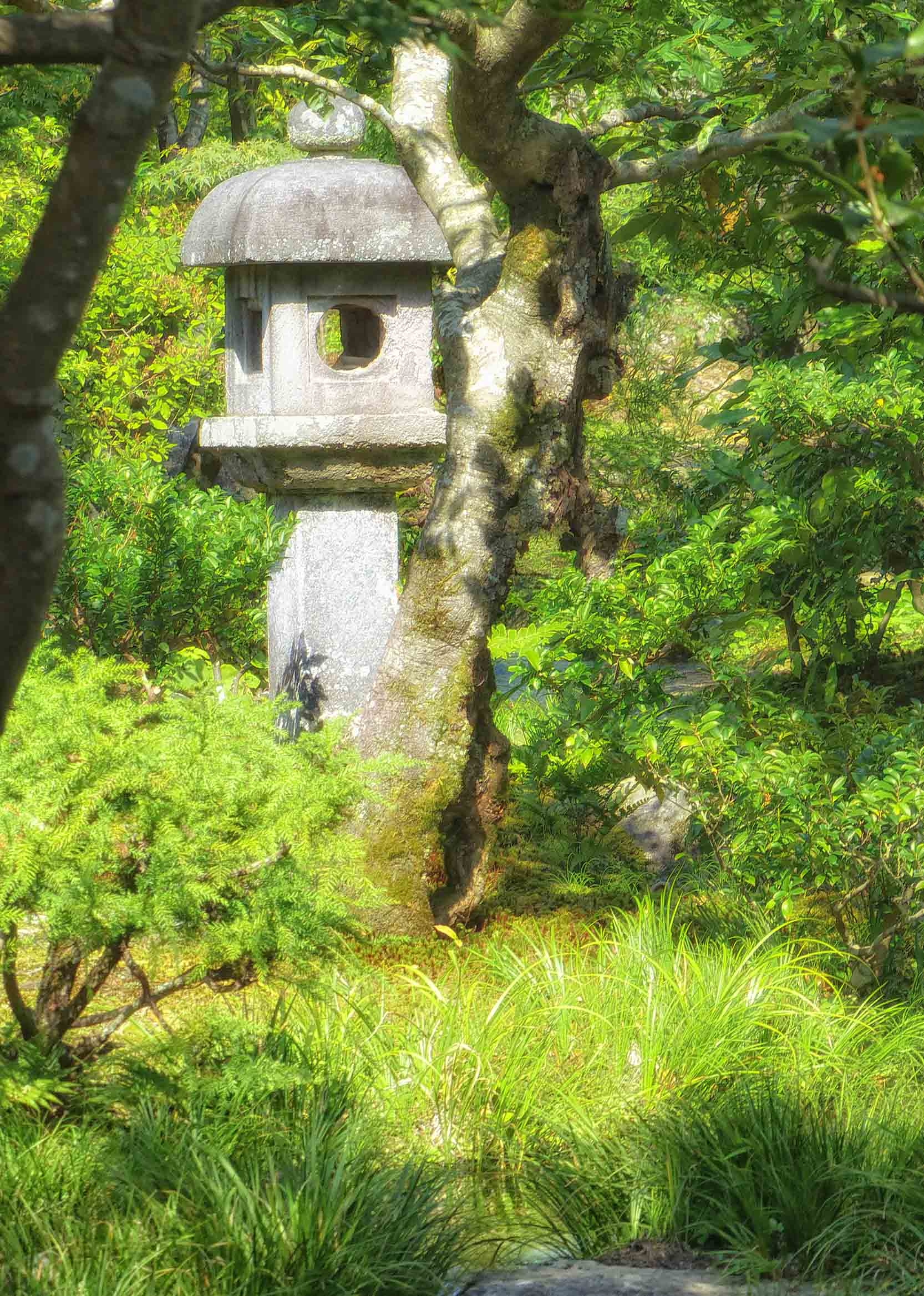 Stone shrine among trees