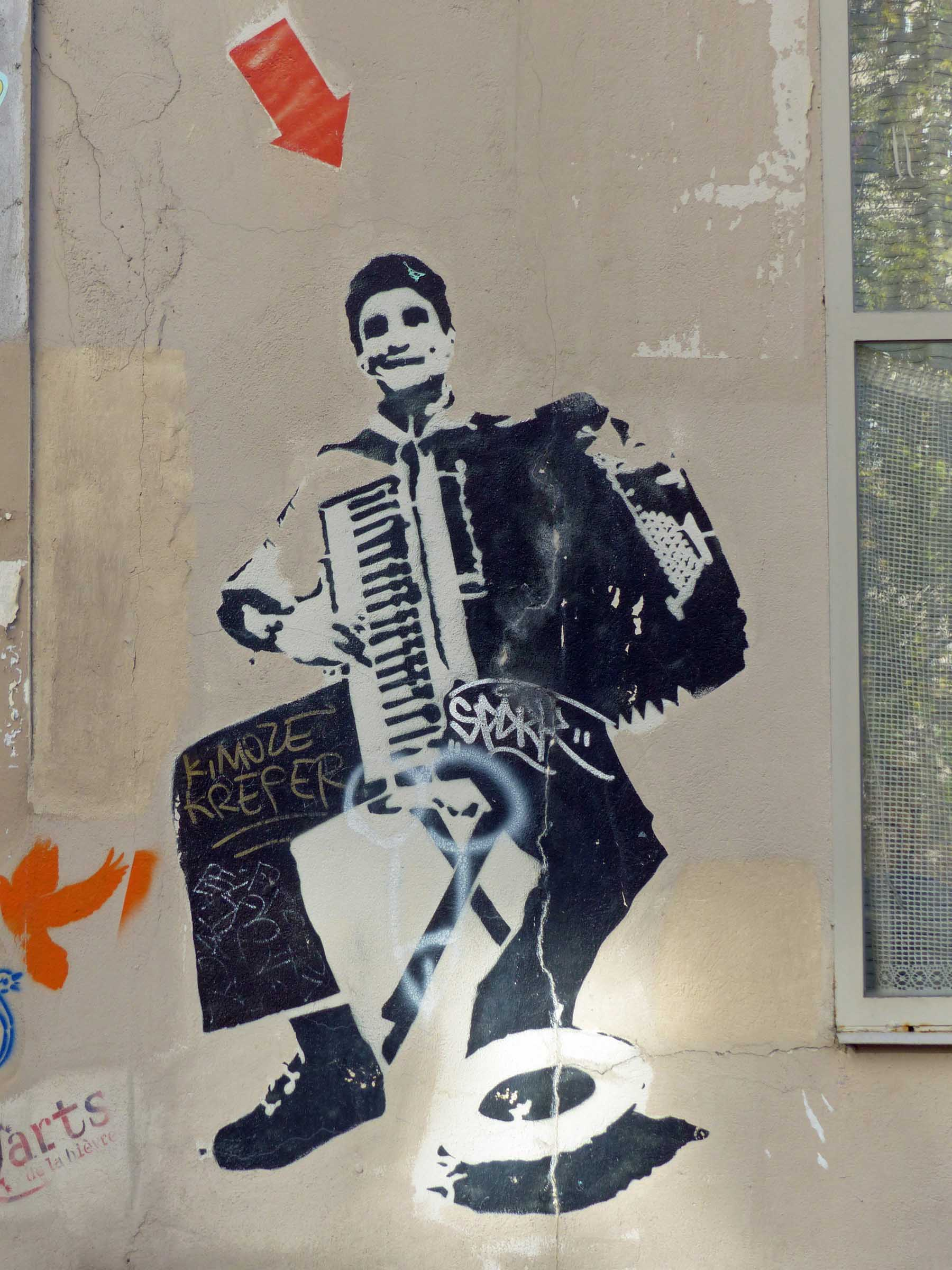 Painting of an accordion player on a wall