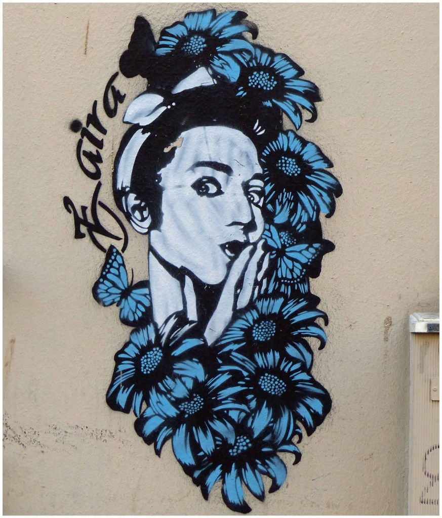 Painting of girl's head surrounded by blue flowers