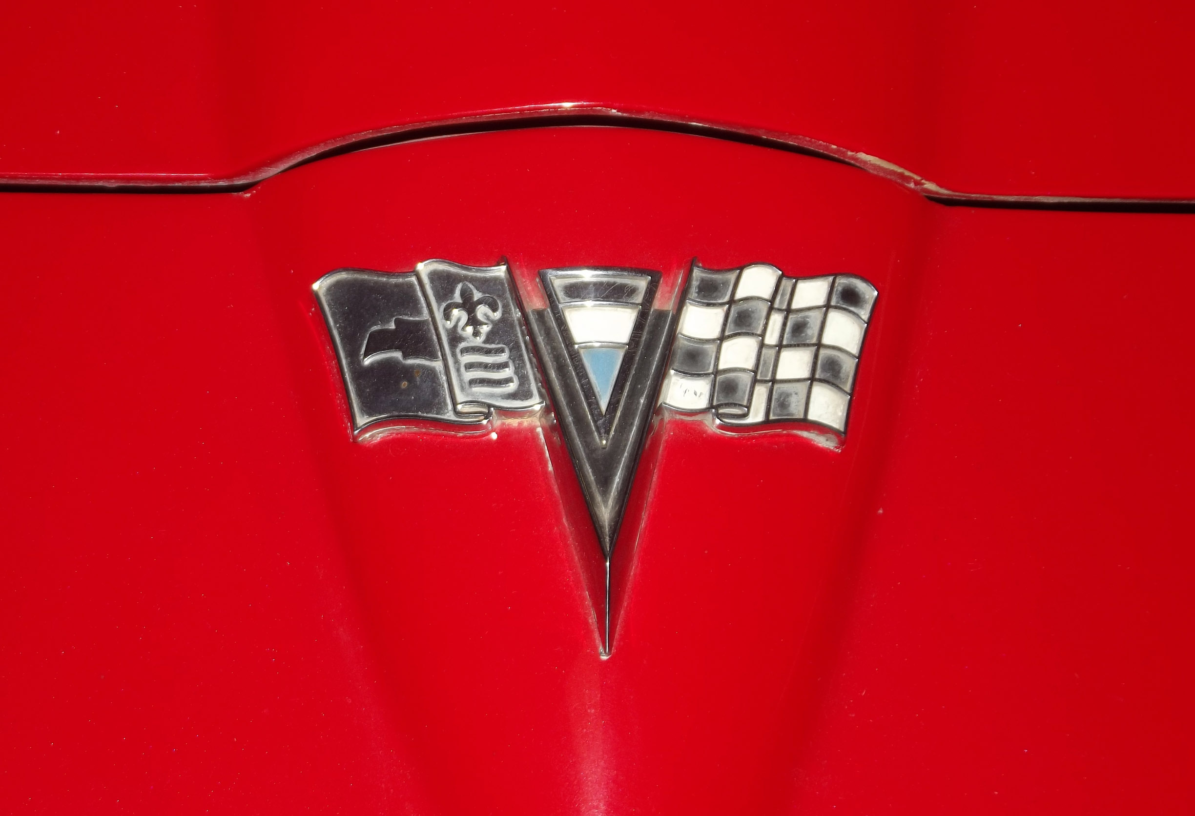 Detail of badge on bright red car