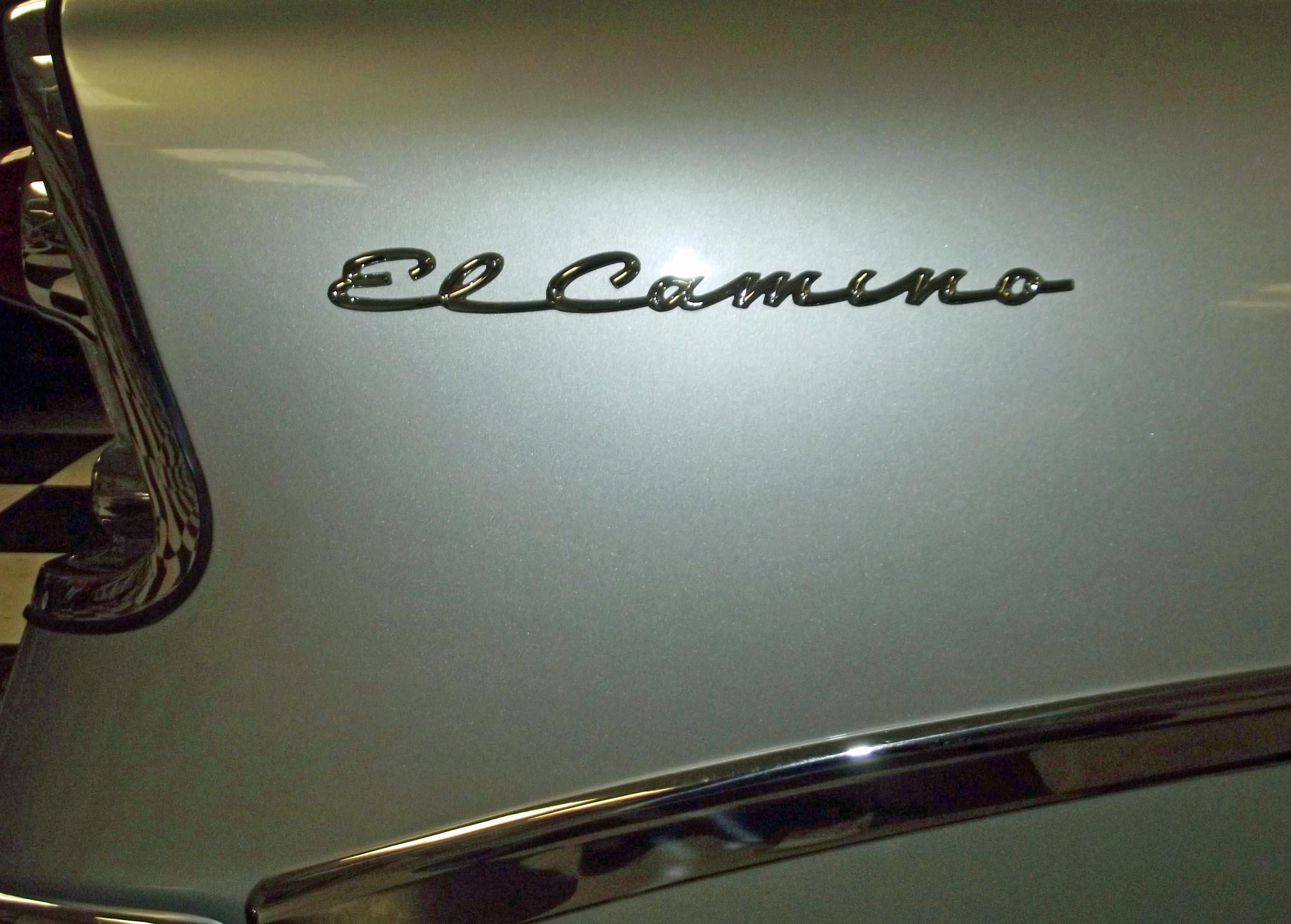 Silver logo on a white car