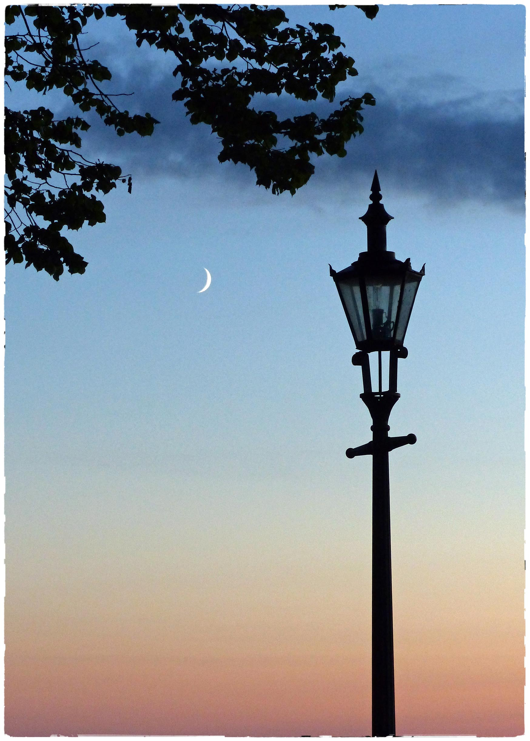 Sunset with lamppost and crescent moon