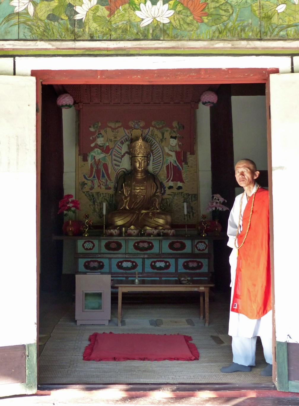 Buddhist monk at door of temple