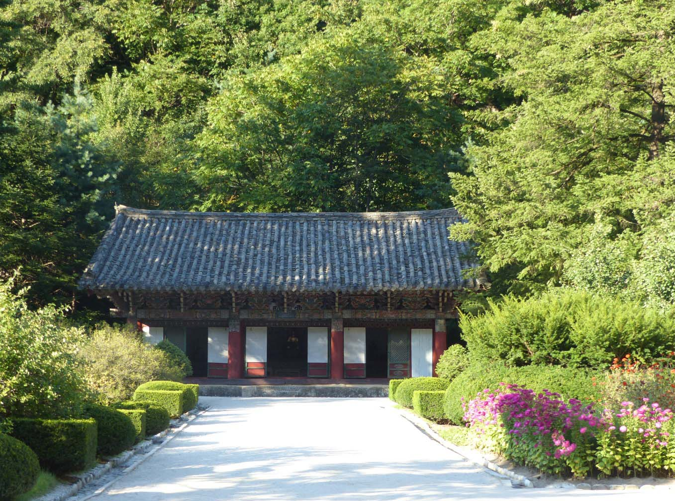 Oriental temple surrounded by trees