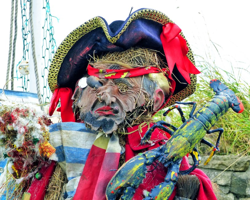 Pirate figure in bright fabric with hat and lobster