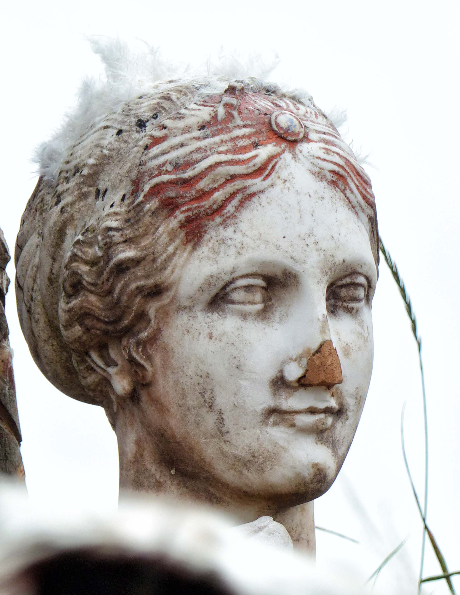 Girl's face from a statue with chipped nose