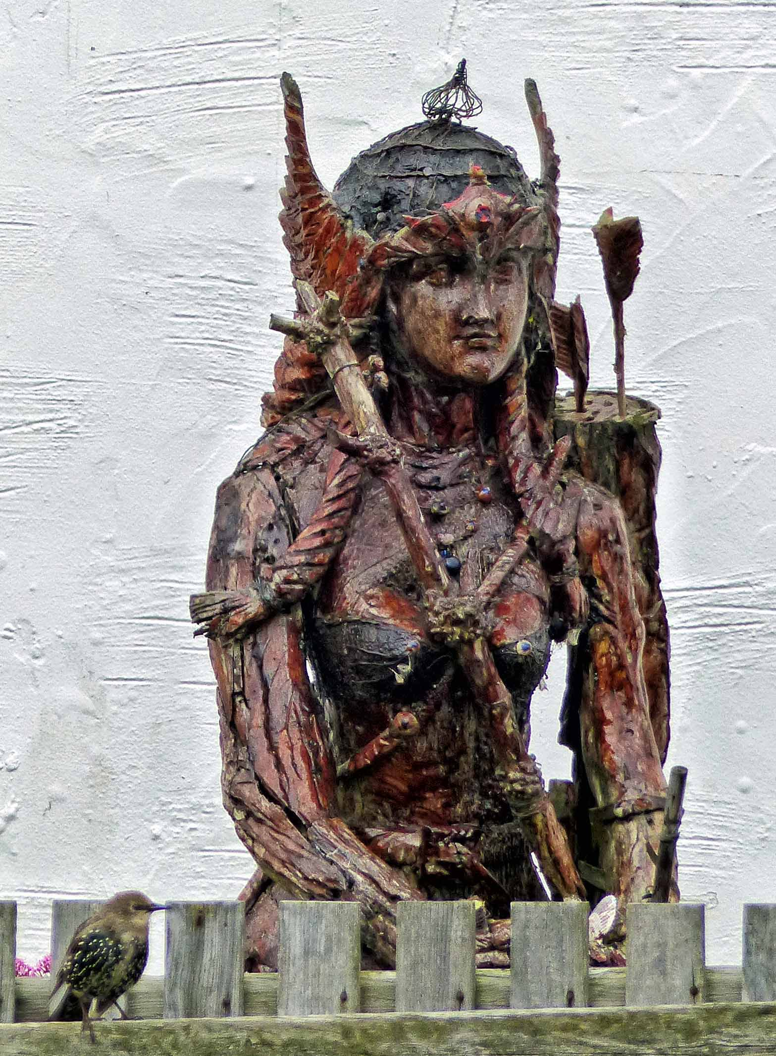Carved wooden figure painted red