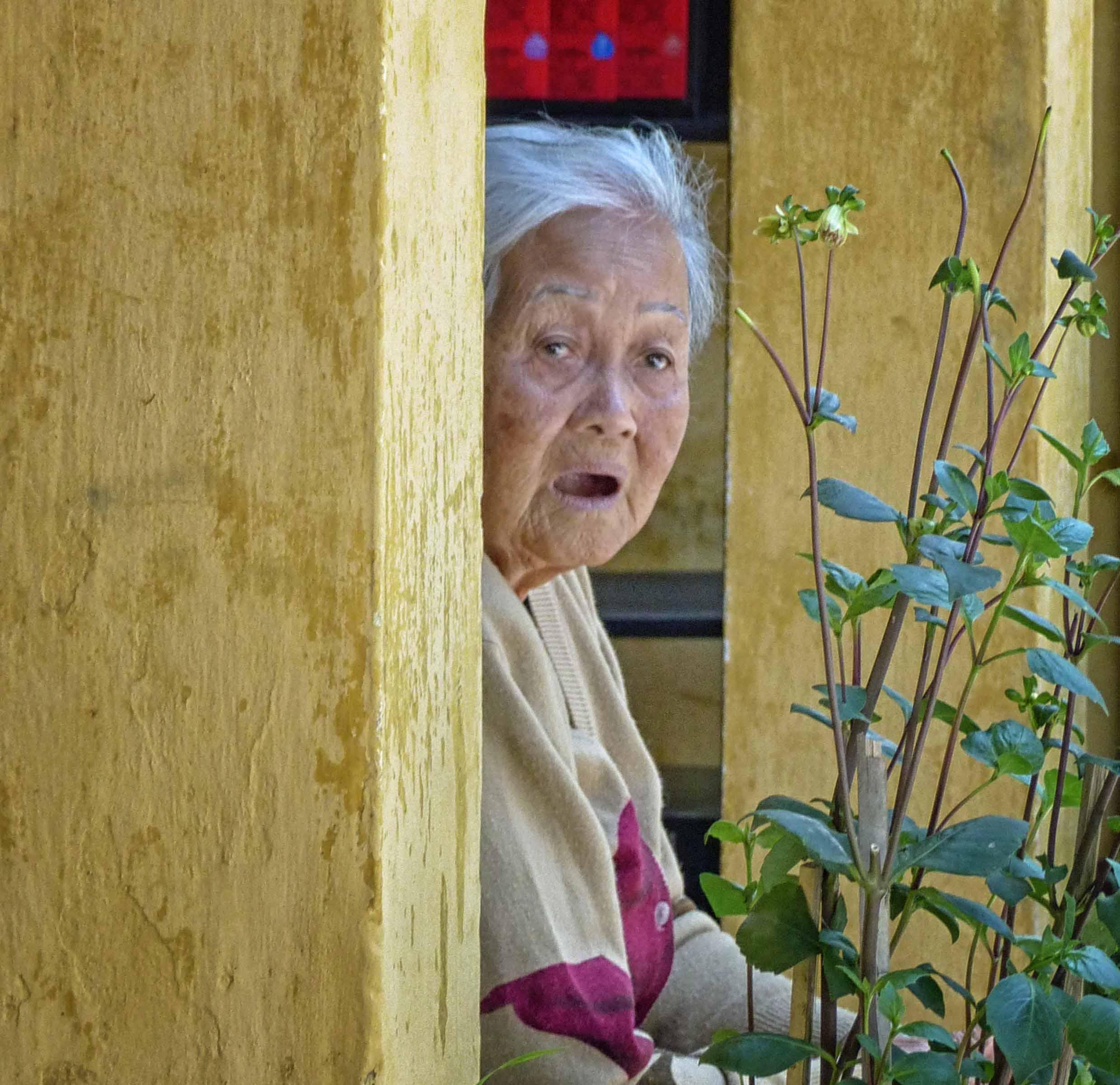Elderly lady looking surprised