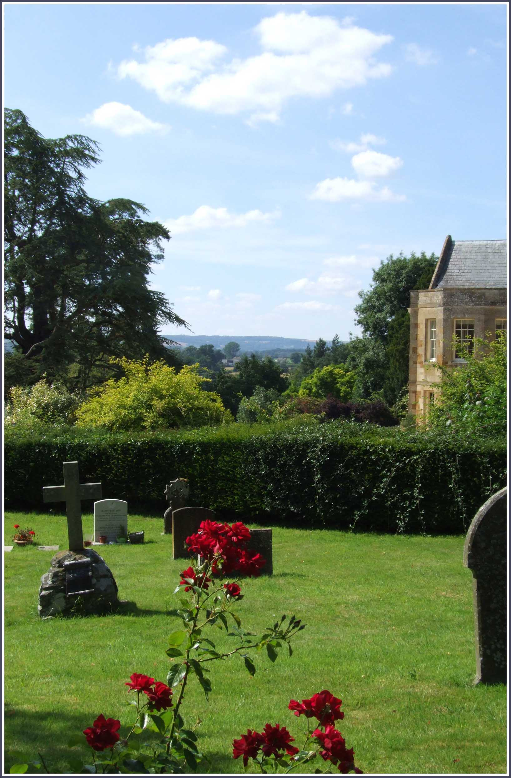 Gravestones with trees and hills beyond