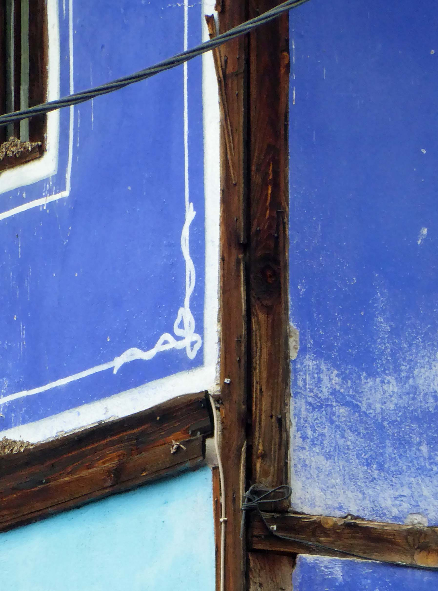 Timbered house painted blue