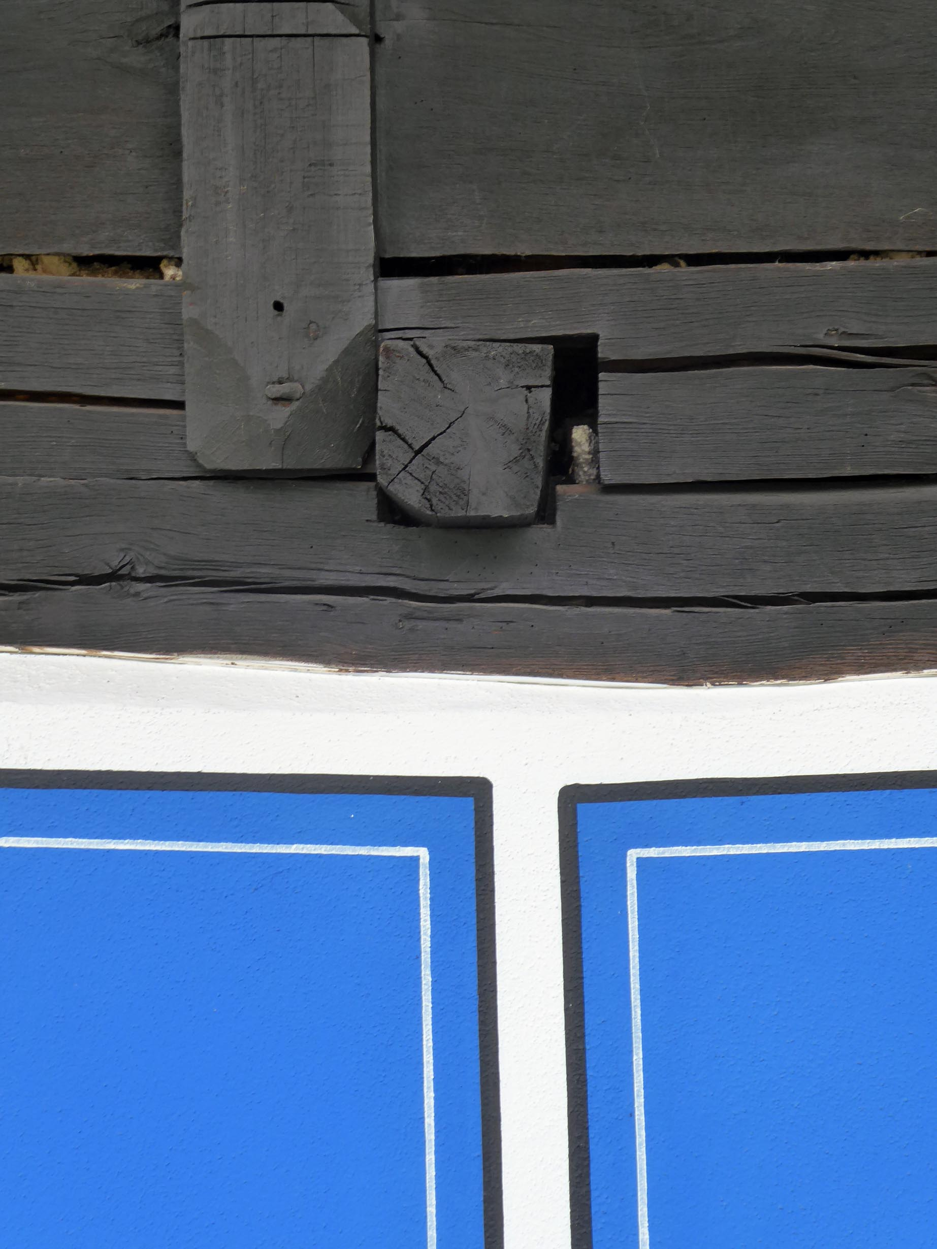 Wooden beam and blue painted wall
