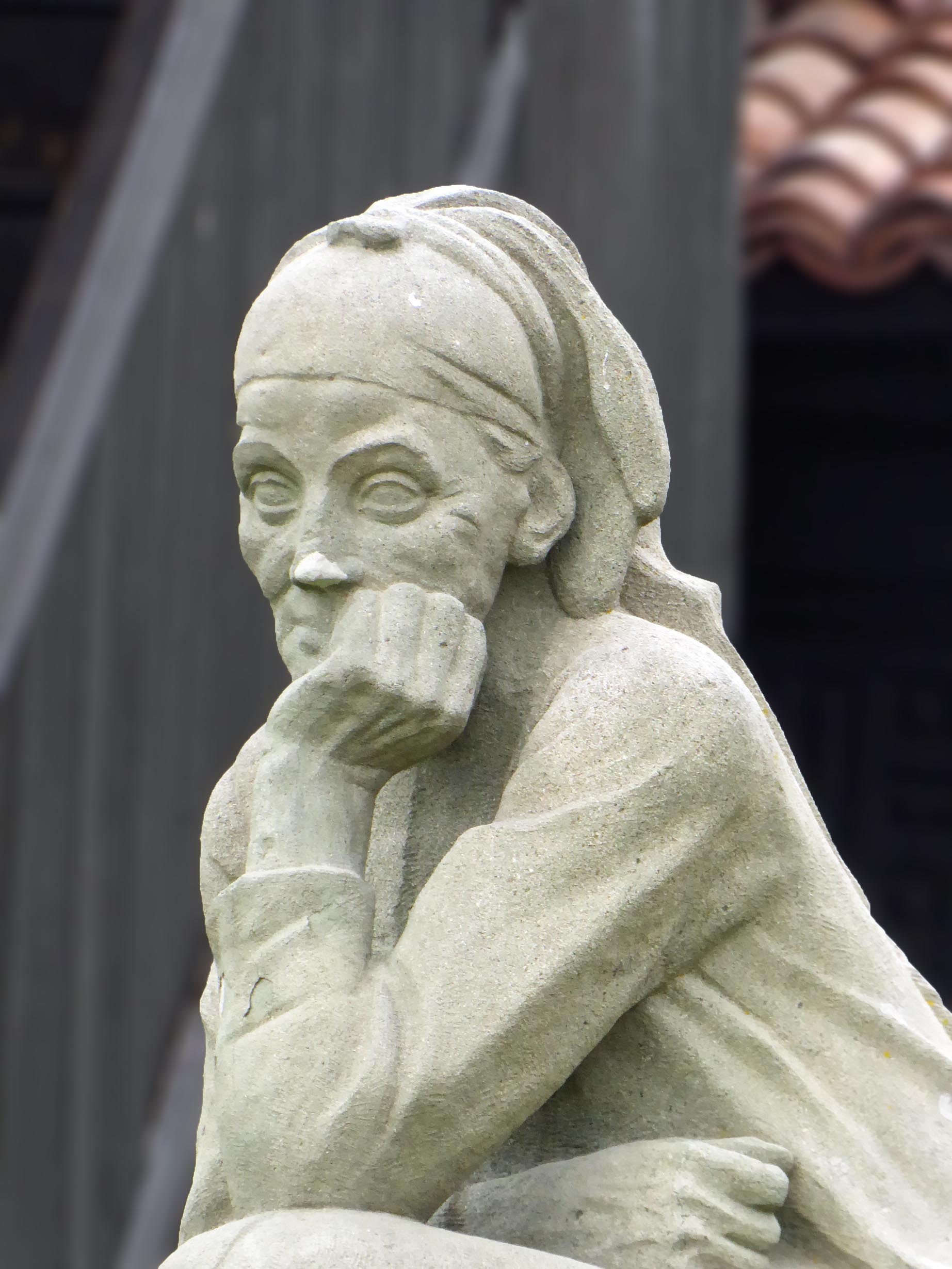 Statue of a woman resting her head on one hand