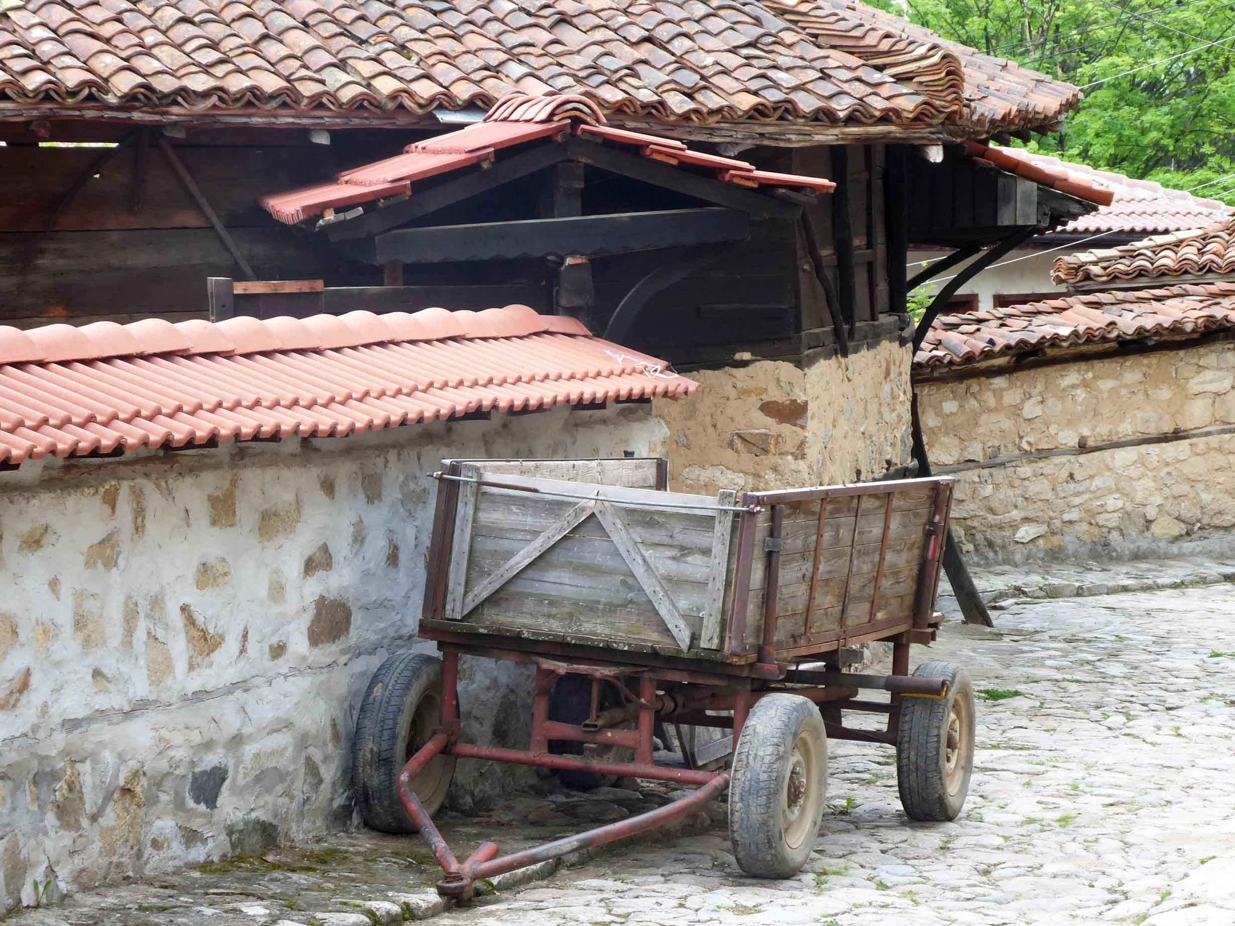 Old wooden cart on cobbled street