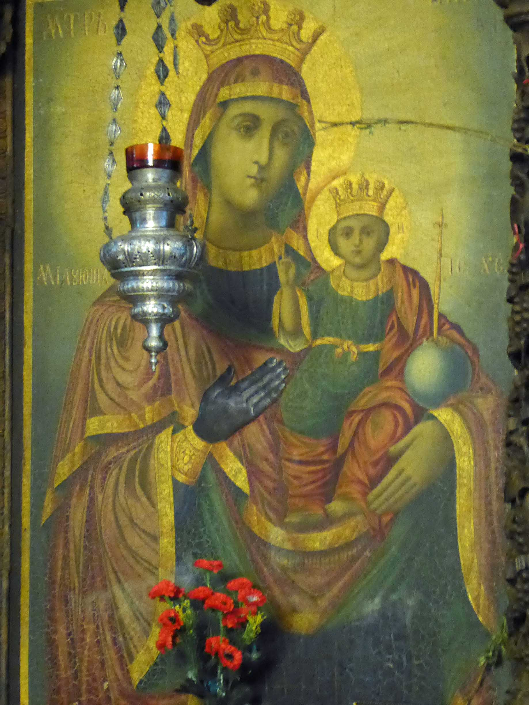 Icon with offering of red flowers