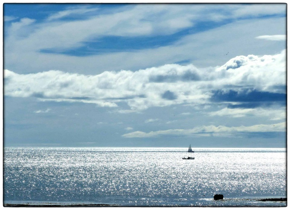 Sparkling sea and small boats