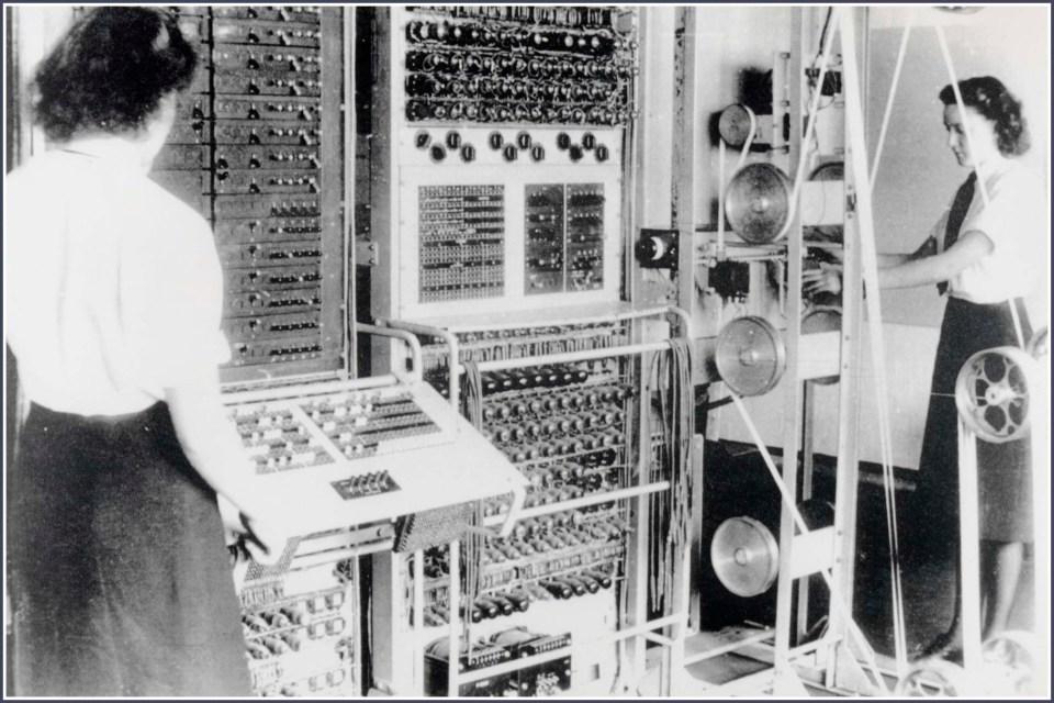 Black and white photo of women operating machinery