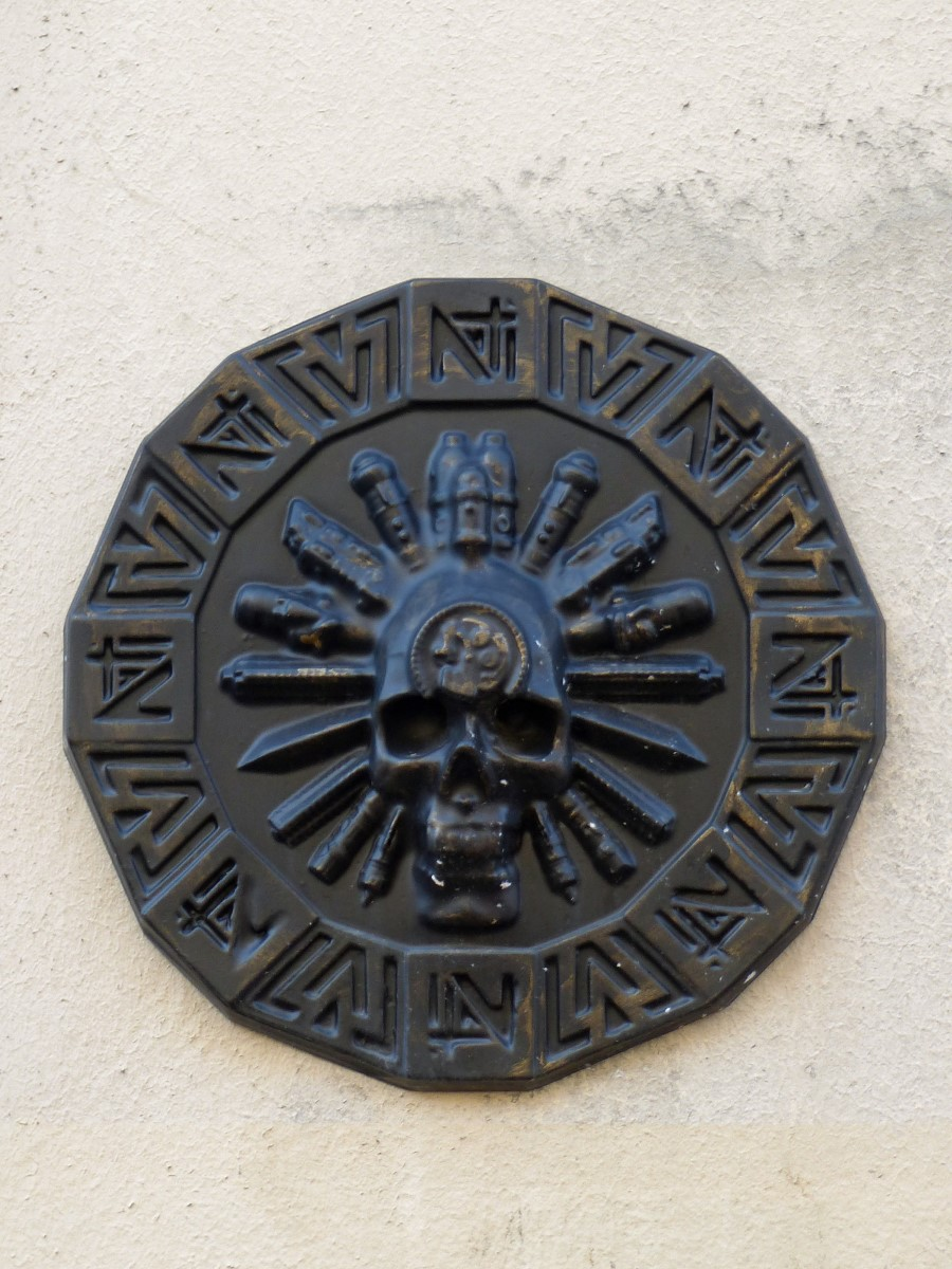 Metal plaque with skull