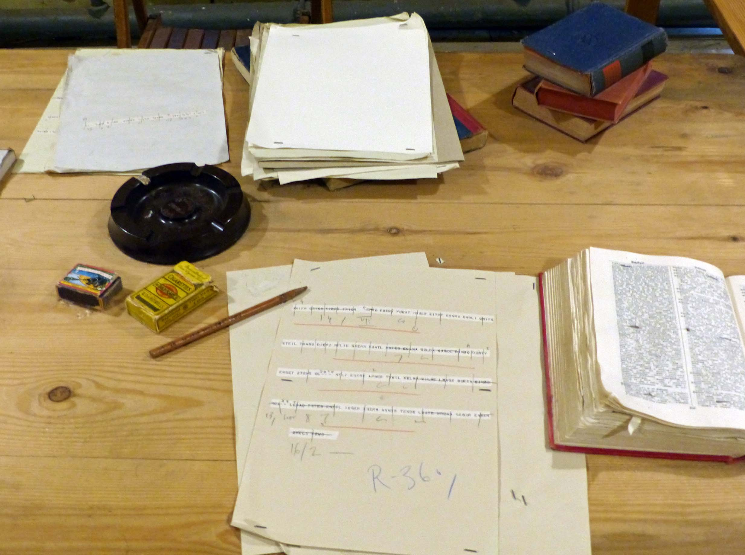 Various papers and books on a desk
