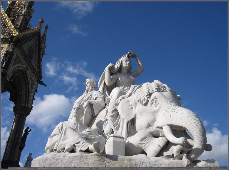 Sculpture with white elephant and group of people